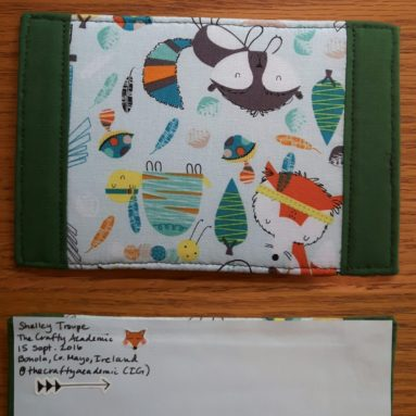 Back and front of first fabric postcard